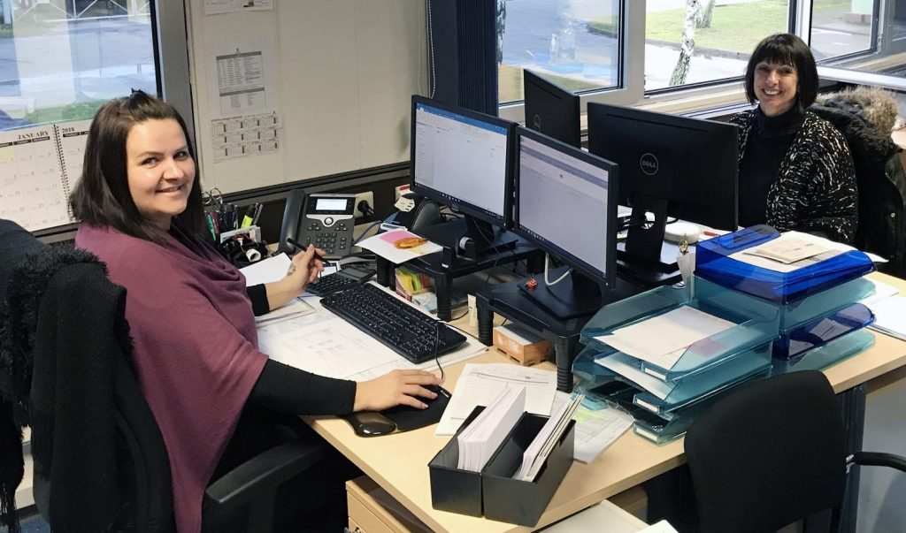 Germersheim D.C. Payroll Clerks Katharina Ciura and Gabi Hooper practice good office ergonomics by using monitor stands, mouse pads with gel pads for wrist support and foot rests at their work stations.
