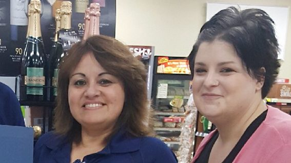 ROBINS AFB, Ga. - Maria Christina Negron, center, receives an award from LP's Brittany Gentry and Store Manager Maria Hood for helping the store avoid a loss after she caught a customer trying to sneak six cases of beer and a bottle of Crown Royal out of the store in a shopping bag.