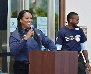 Store Manager LaToya Harris serves as MC during grand re-opening ceremonies at the Yokota AB Exchange.