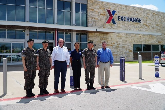 Republic of Korea MG Sangbum Shin, second from right, visits the Fort Hood Exchange with two of his top assistants. Joining them are Tom Lozier, the Exchange's senior vice president for supply chain, Main Store Manager Sandra Reed and Alan French, vice president of the Logistics Directorate.  COL Sukwon Lee and LTC Jinwook Lee