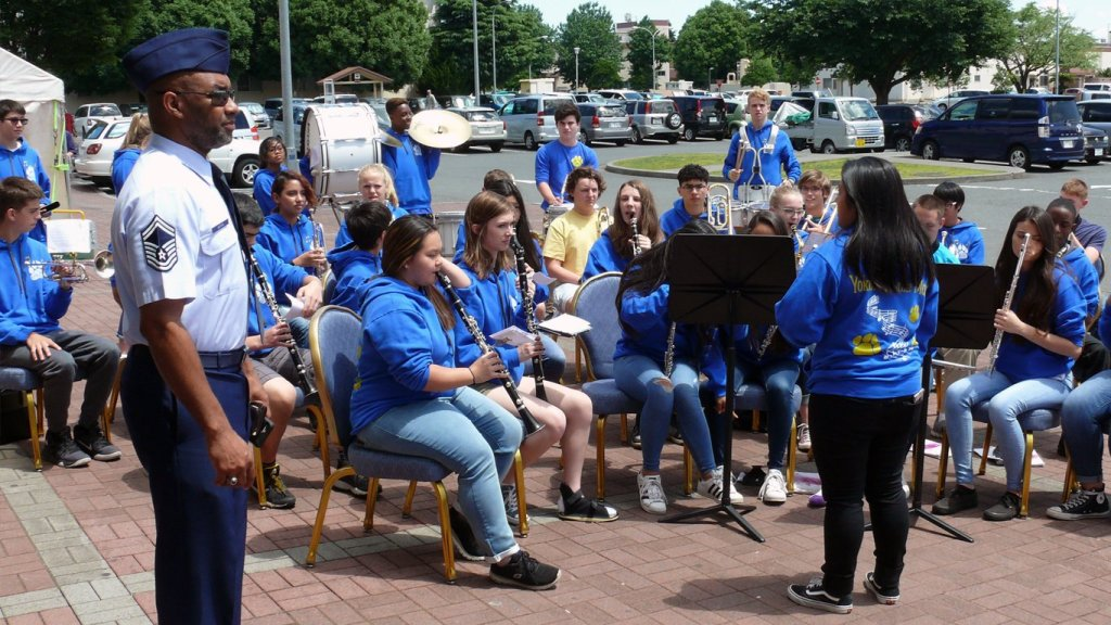 A student band from an installation school entertain the crowd at the grand re-opening of the Yokota AB Exchange.