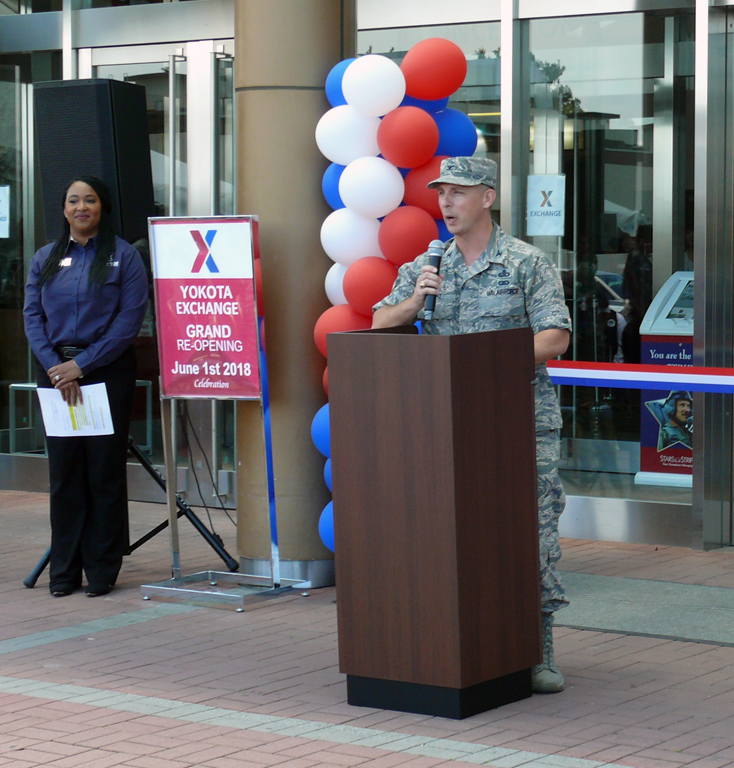 Exchange Pacific Region Commander Col. Scott Maskery addresses the audience during the grand reopening of the main store at Yokota AB. At left is Store Manager LaToya Harris.