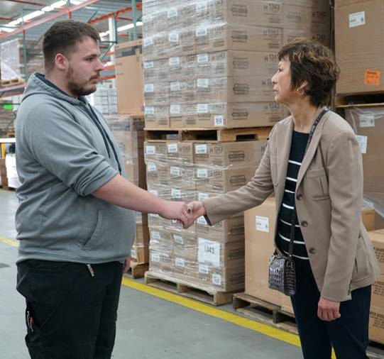 Acting Warehouse Foreman Sven Ritter meets Executive Vice President and Chief Logistics Officer Karen Stack. Ritter worked in Building E.
