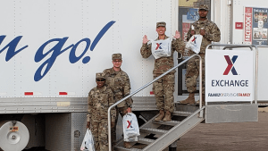 Soldiers come out of the mobile field exchange at Davis-Monthan AFB with sacks full of basic necessities.