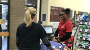 Larissa Odom waits on a valued customer at the Arnold AFB Exchange.