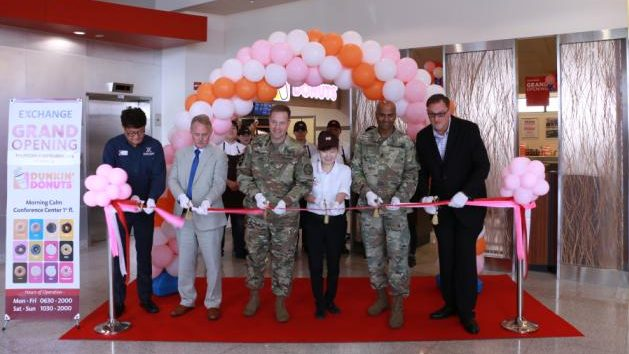Members of Camp Humphreys command and Exchange leaders cut the ribbon at the grand opening of Camp Humphreys' Dunkin' Donuts in South Korea.