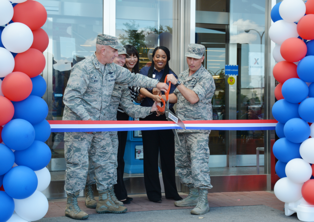 From left, Col. Kenneth Moss, 374th Airlift Wing commander; Col. John Winkler, 374th Mission Support Group commander; Shinobu Matsui, Exchange general manager; Latoya Harris, main store manager; and Col. Scott Maskery, Pacific Region commander, cut the ribbon on a $4.7 million renovation to Yokota AB's store June 1.