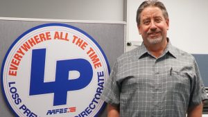 Steve Boyd, vice president of the Loss Prevention Directorate, with the LP logo.