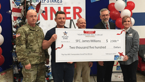 Left to right, Garrison Command Sgt. Maj. William D. Lohmeyer, SFC James Williams, Fort Bragg General Manager Bill Shoffner, Exchange Executive Vice President and Chief Financial Officer Jim Jordan, and Store Manager Trish Jones.