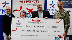 Left to right: Exchange West Coast Regional Vice President Robert Rice; sweepstakes winner (Ret.) Capt. Doris Jackson; Exchange General Manager Matthew Beatty; and 99th Air Base Wing Vice Commander Col. Michael T. Davis.