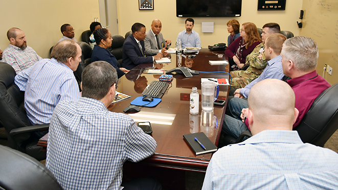 Leaders of the Exchange's Logistics Directorate meet with a member of the Headquarters, Department of the Army (HQDA) G-48 and a project manager to talk about transportation of goods to Warfighters.