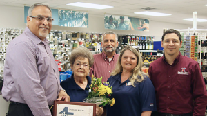Eighty-four-year-old Charlsie Dean celebrates her golden anniversary with the Exchange at the Fort McClellan National Guard Troop Store. Joining her in a picture are, left to right, Jesse Martinez, southeast region vice president, who is presenting her with a Thanks award; Don Sydlik, general manager; Lucretia Palmer, McClellan store manager; and John Seward, regional HR manager.
