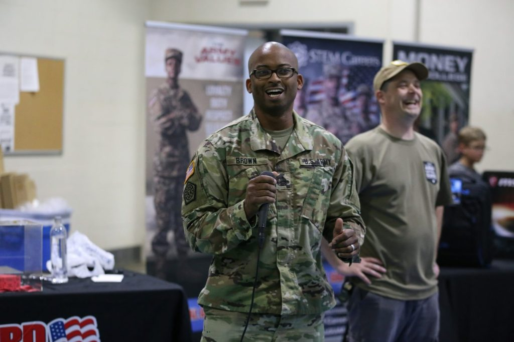 Sgt. 1st Class Brown, the winner of the Camp Mabry event, addresses the crowd by microphone