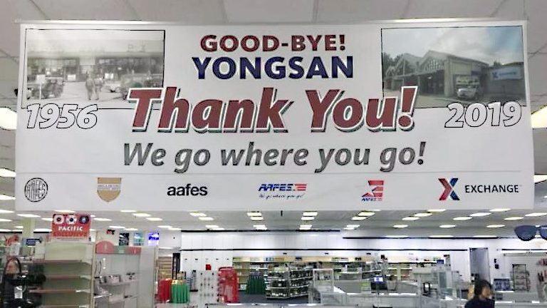 Associates tell their customers goodbye at Yongsan.