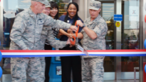 YOKOTA AB, Japan - From left, Col. Kenneth Moss, 374th Airlift Wing commander; Col. John Winkler, 374th Mission Support Group commander; Shinobu Matsui, Exchange general manager; Latoya Harris, main store manager; and Col. Scott Maskery, Exchange Pacific Region commander, cut the ribbon June 1 on the renovated   Yokota Exchange.