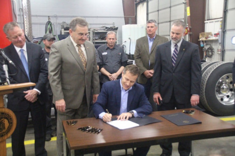 Greitens signs Corlew's expert witness standards bill