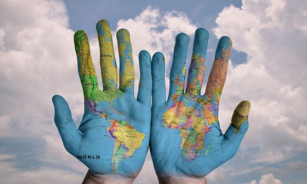 world-map-painted-on-hands