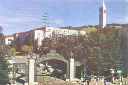 1940s postcard of Sather Gate showing cars parked on the Bridge, and the bollards that barred through traffic.