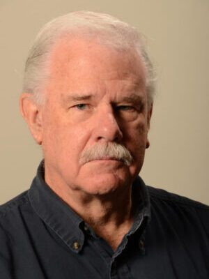 Faculty Headshot for George Sensabaugh
