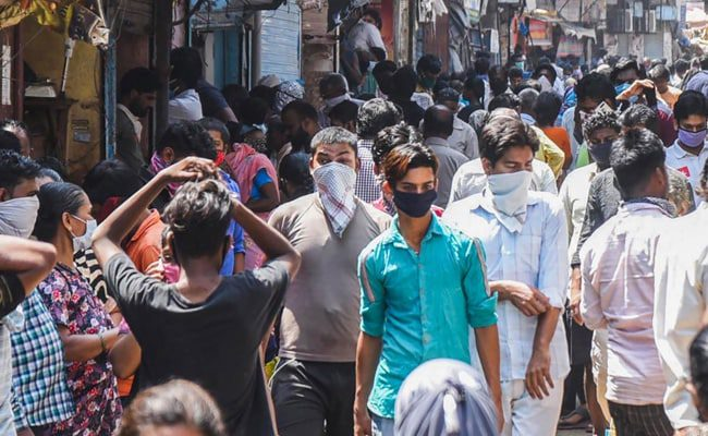 A street scene in India with people in face coverings.