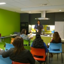 Jose Romo, Nutrition Assistant, conducting a cooking demonstration for WIC clients to encourage them to try healthy new recipes.
