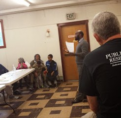 Dave Nichols, manager of the Public Health Reserve Corps (in foreground), providing a training on opening a shelter with the Somali Health Board. The Somali community is now prepared to set up an emergency shelter at a local Islamic center if the need arises.