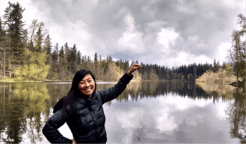 Sinang Lee, Environmental Health Educator, surveys fishable lakes to develop a King County map that promotes healthy consumption of local fish. She's holding fishing line found on the public dock at Deep Lake near Black Diamond.