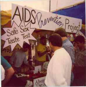A booth in the late 1980s early 1990s at a Pride Festival in what was then the Bobby Morris Playfield and is now Cal Anderson Park. The booth invited people to taste different flavored lubes and condoms.