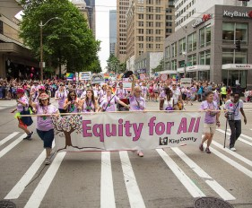 Our director, Patty Hayes (center) holds up the banner for Equity for All in all the work we do.