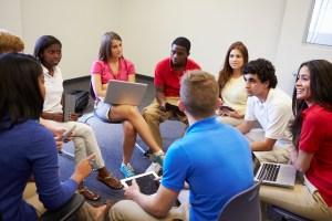 teens talking in classroom