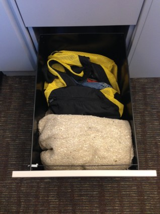 """Melissa Krueck, Training and Exercise Manager, Preparedess: """"I have dedicated a drawer in my office space for personal preparedness items. In this drawer I have spare clothes, toiletries, shoes and a blanket in case I have to spend the night in Chinook. I also store bottled water and snacks in this drawer in the event of an emergency."""" Bonus tip: snacks come in really handy if you get stuck in traffic during a snow fall or when the President of China comes to visit."""