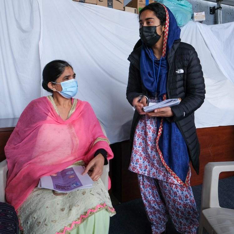 Two women in masks