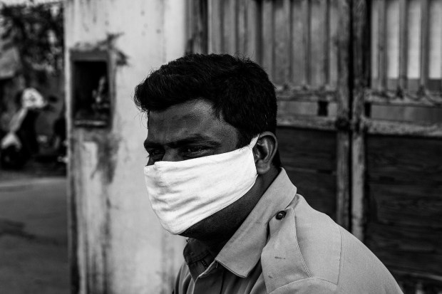 Indian man in a COVID mask