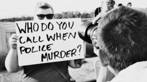 Sign at an anti-police brutality in Dallas © Helium Factory | Flickr