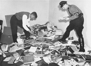 German students and Nazi SA plunder the library of Dr. Magnus Hirschfeld, Director of the Institute for Sexual Research in Berlin. The materials were loaded onto trucks and carted away for burning. © Unknown | United States Memorial Museum