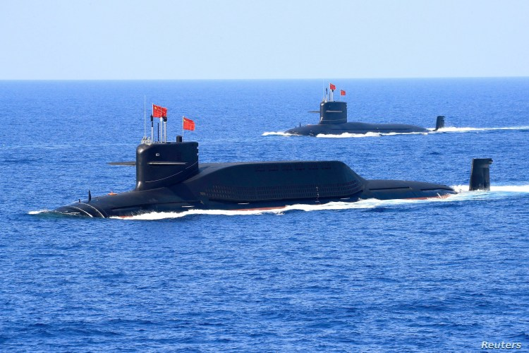 FILE - A nuclear-powered Type 094A Jin-class ballistic missile submarine of the Chinese People's Liberation Army's navy is seen during a military display in the South China Sea, April 12, 2018.