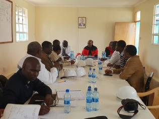 PS Paul Maringa chairs a site meeting accompanied by QS Alphonce Okweto, Works Secretary, State Department of Public Works.