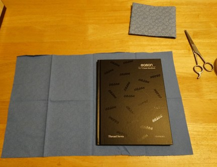 Cut enough fabric to cover notebook