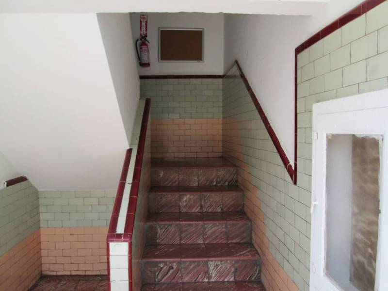 Entry stairway with original tiles.