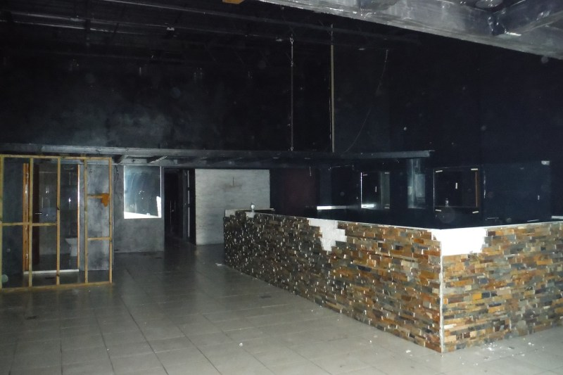 Main floor formerly used as a bar/disco - bar will be removed by owner.