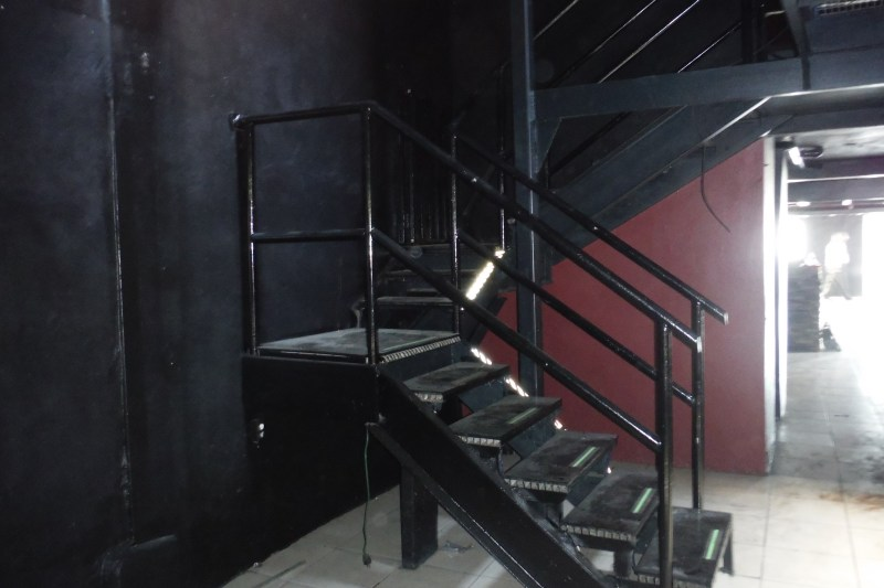 Structural steel staircase to mezzinine and roof.