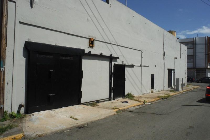 """Garage door has 7'5"""" clearance.  Main door slides with additional door inset."""