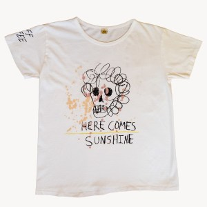 white t-shirt with here comes sunshine and skeleton illustration
