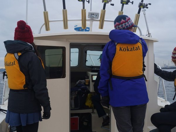 Volunteers aboard the Soundkeeper patrol boat in winter.