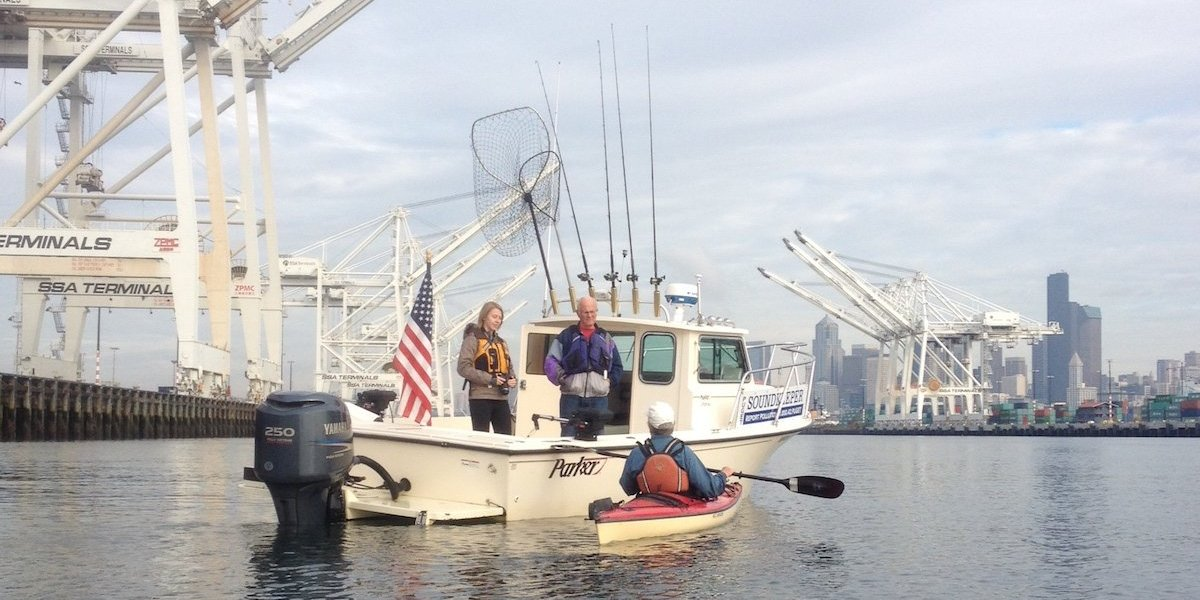Soundkeeper boat and kayakers on patrol.
