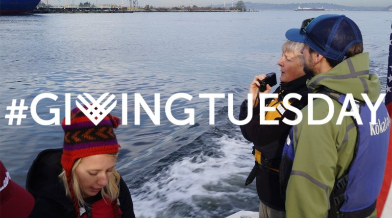 The Giving Tuesday logo appears over an image of people on a boat on Elliott Bay, looking out at the water.