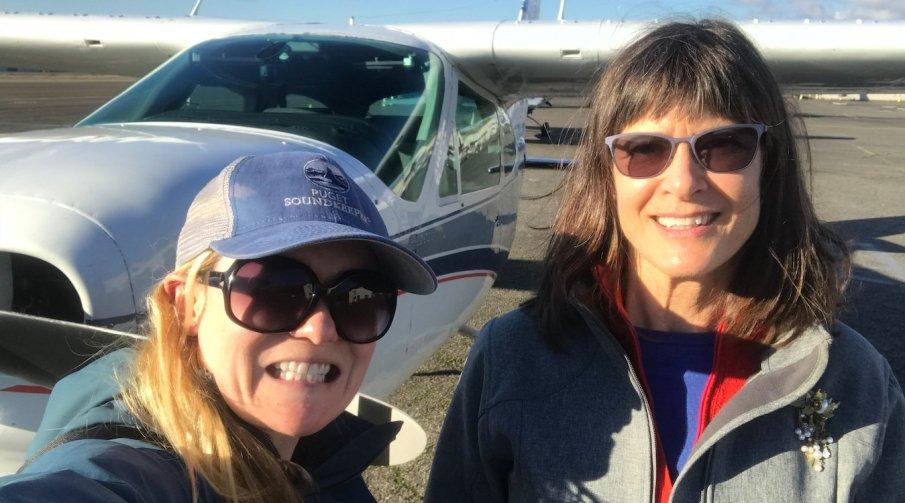Puget Soundkeeper staff take a selfie with the LightHawk pilot after a flight.