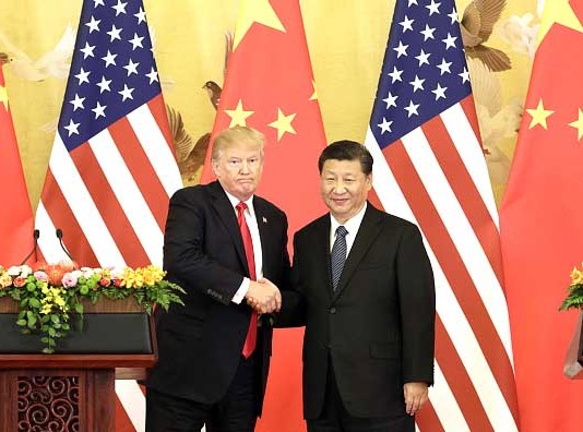 U.S. President Donald Trump, left, and Xi Jinping, China's president, shake hands during a news conference at the Great Hall of the People in Beijing, China, on Thursday, Nov. 9, 2017. Donald Trump and Vladimir Putin will meet in Helsinki, Finland, on July 16 for their first bilateral summit as the leaders seek to reverse a downward spiral in relations that has been exacerbated by findings that Russia meddled in U.S. elections. Our editors select a set of archive images of U.S. President Donald Trump ahead of the summit meeting. Photographer: Qilai Shen/Bloomberg via Getty Images