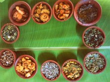The Kuzhambus , Sambars and Rasamsa for the day. How beautiful does that look? L-R from below - Sprouts salad, Potato roast, Karamani, Menthiya keerai (fenugreek leaves), Avarai, Ponnankanni Keerai, Pulicha Keerai (with cold pressed sesame oil and shallots - my personal favourite), Kovakkai, Pavakkai (bitter gourd) and Vazhaikkai (raw banana). — at Trichy Tamilnadu.