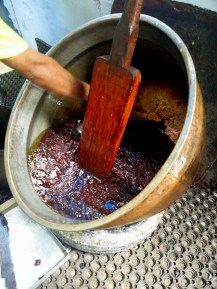 Age old cauldrons and wooden spatula used to make this halwa